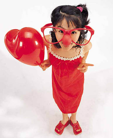 silly girl with red heart balloon