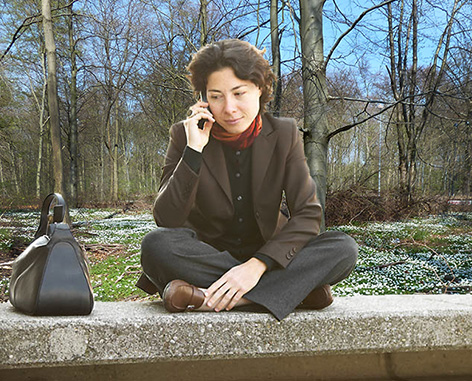 woman talking to husband on cell phone