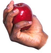 letting go hand holding apple