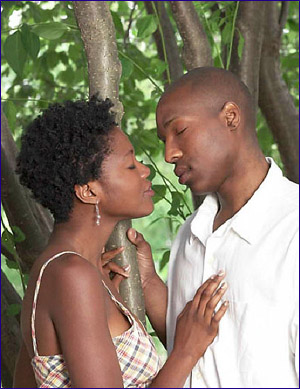 Love Tips - afro american couple in love hand on heart eyes closed